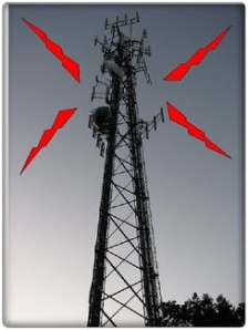 Multitude of antennae atop the tower emits pulsing microwaves.