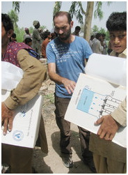 Giovanni Lo Porto, second from left, in a 2011 photograph, at work in Multan, Pakistan. He was killed in a drone attack in January