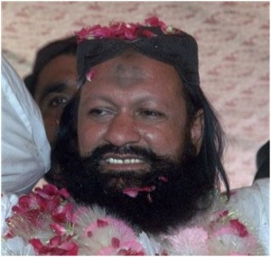 In this photo taken on July 15, 2011, Malik Ishaq is greeted by supporters with rose-petals upon his arrival in hometown after his release from jail, in Rahim Yar Khan