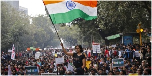 A demonstrator waves the Indian national flag during a protest on February 18, 2016, in New Delhi, India, demanding the release of Kanhaiya Kumar, a student union leader accused of sedition. In 2016 there has been a spike in the number of sedition cases filed nationwide.