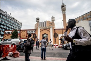 The East London Mosque, which serves residents of Bethnal Green, abuts London's financial center